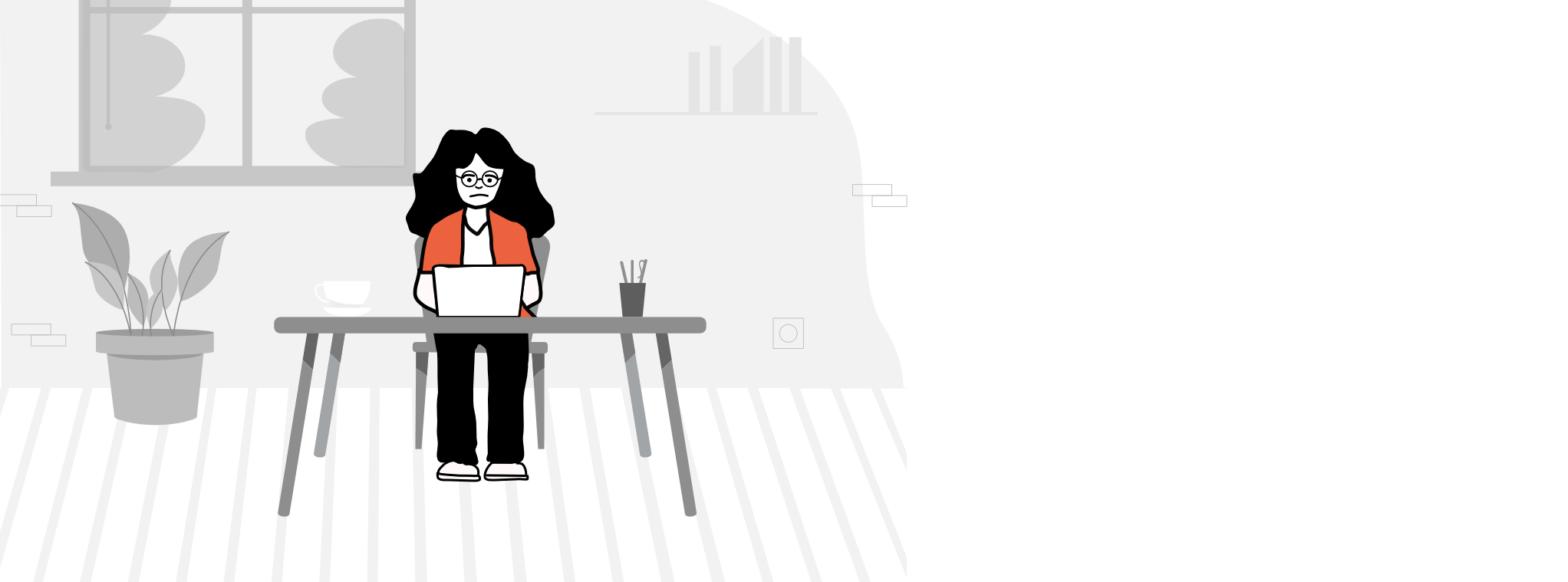 Sieviete sēž pie galda un kaut ko dara pie portatīvā datora