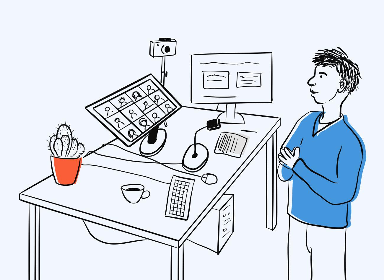 Vīrietis skatās uz monitoru un runā ar cilvēkiem